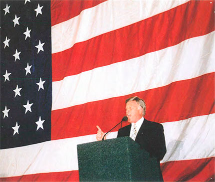 Pat Conley addressing the audience at Rhodes on the Pawtuxet in 2003