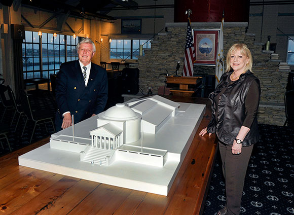 Pat and Gail Conley unveil their model of the proposed building for the Rhode Island Heritage Hall of Fame at the Conley Conference Center in April, 2016